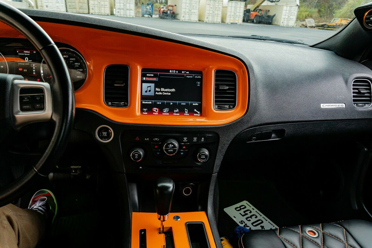 Custom painted orange dash in dodge charger